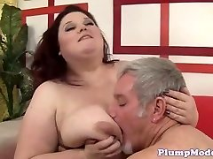 Red-haired BBW with immense boobs gets screwed