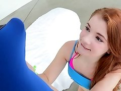Young petite red-haired taking a big knob