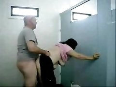 Old dude boinks this chubby busty grandmother in a public toilet