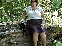Upskirt rump in the woods part 2