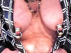 Mature Shakes Heavily jeweled titties