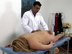Humungous blonde female gets fucked on the massage table