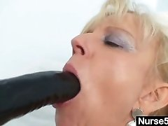 Old blonde cougar stuffing pussy with huge fake penis