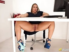 Chubby English nympho Ashley Rider fondles her enormous pussy in the office