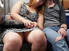 Enormous gal on the subway sits with her legs open