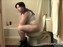 Plump Lady Using the Bathroom