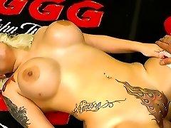 Tattooed slut with piercings enjoys gangbang orgies