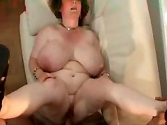 Granny with hefty tits.stomach & glasses