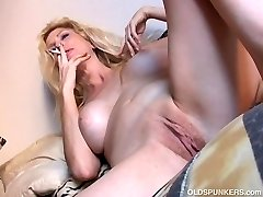 Sexy old spunker has a smoke & plays with her succulent puss