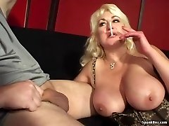Huge-titted mom gives blowjob and smokes cigarette