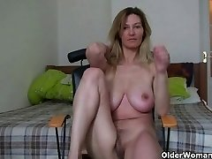 Cougar with big breasts rubs her mature pussy