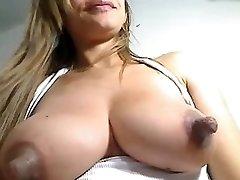 Huge nipples on milk filled boob