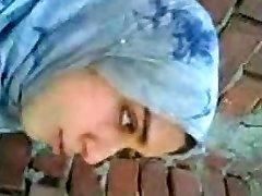 arab girl smooching boyfriend