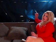 Buxom blonde smoking