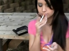 Holding a ciggie and taunting her friend