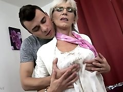 Horny granny with saggy baps fucked by a young guy