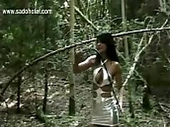 Dirty slave tied to a tree is hit highly rigid with a cane by horny mistress