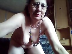 Kinky fur covered grandmother enjoys peeing in the bucket