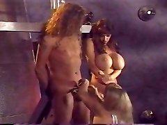 Big-boobed dominatrix has fun with her slaves