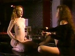 Redhead slave licking dominatrix' breasts