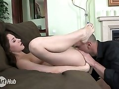 Lovely bootylicious pale brunette sexpot gives footjob before missionary penetrate