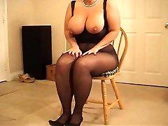 Busty bodacious MILF in pantyhose heeljob