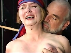Cute young platinum-blonde with perky melons is restrained for nipple clamp play