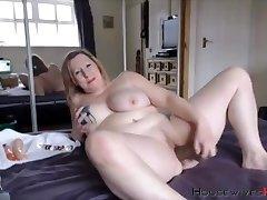 BBW mature Carmen with huge tattooed tits rides a dildo