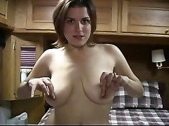 Horny brunette with big fun bags plays with her pussy on her couch