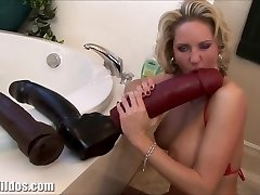 Huge-titted cougar squirting from a huge dildo