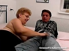 A large granny has sex