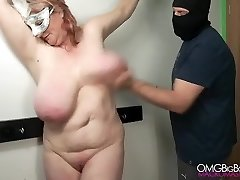 Spanking my slave's humungous tit until she comes