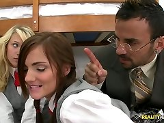 Skimpy students Teagan Summers and Lily Carter give double blowjob to their teacher