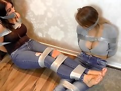 two enormous breast gals tied up with ductape