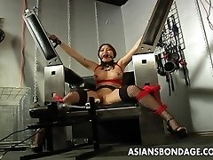 Big-chested brunette getting her wet pussy machine penetrated