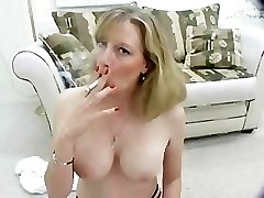 Hot Cougar smokes topless for you