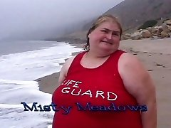 Fat lifeguard tramps gobble food on the beach