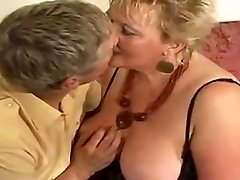Enormous golden-haired granny drilled by youthful dude