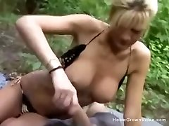 Big tit milf in bikini faps off her boyfriend in the woods