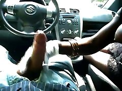 Black girl with big bosoms gives hand job in car