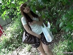 Beautiful and nosey sandy-haired Asian teen observes sex on the street and masturbates