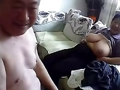 Older Chinese Couple Get Naked and Poke on Cam