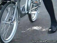 Schoolgirl Pumps Out on a Bike in Public!