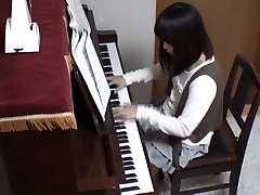 Piano teacher rear penetrates his pupil throughout the piano keys