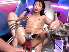 Bound Asian slut gets stimulated by toys to climax