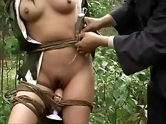 Chinese army girl corded to tree 3
