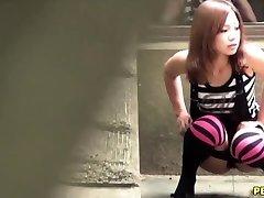 Japanese slut urinate squats
