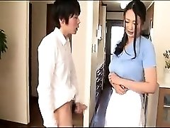 Delectable Chinese housewife working her hands and lips on a