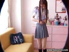 Asian schoolgirl gets hot for lucky spycam