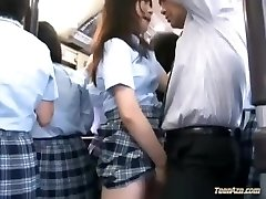 Thirsty Japanese school girl pummeled on a crowded bus